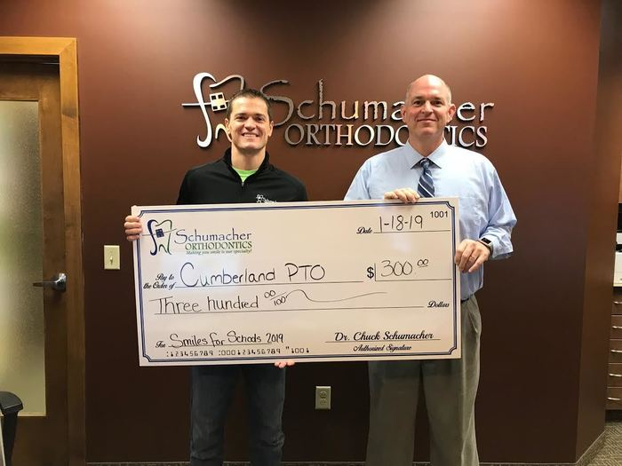 Schumacher Orthodontics presents check to Cumberland schools