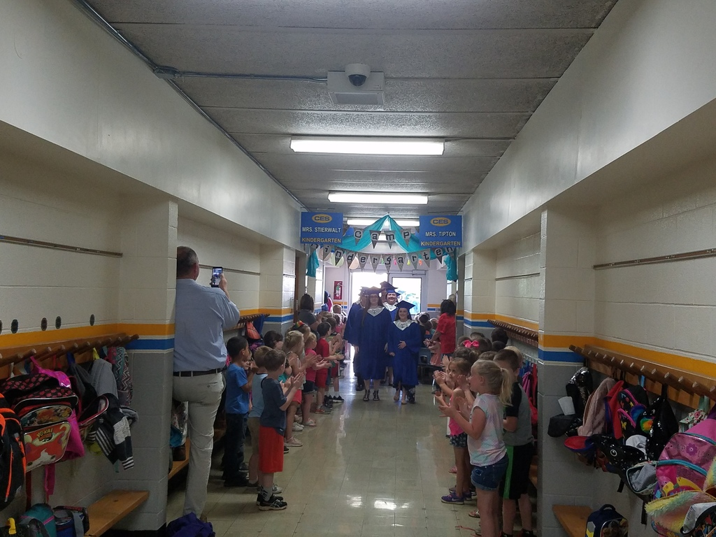 Kindergarten classes clapping for the Seniors